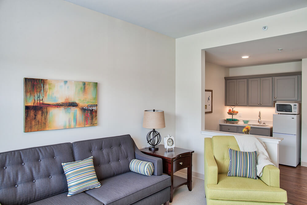 Furnished one bedroom senior living apartment with featured kithcenette